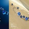 Blue bubbles - Sötétkék gyöngyös drótékszer karkötő, Ékszer, óra, Karkötő, Sötétkék üvegtekla gyöngyökkel díszített drótékszer karkötő. Az ívelt részt ezüstözött ékszerdrótból..., Meska