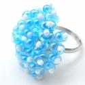 Jégkirálynő gyűrű, Az állítható gyűrűalapra kék farfalle és fe...
