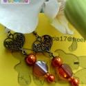 fülbevaló narancsszín, Ékszer, Esküvő, Fülbevaló, Ez a fülbevaló antik szerelvényekre készült, narancs árnyalatú üveg gyöngyökből. Egyedi d..., Meska
