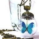 Világító pillangó üveggömbben bronz lánccal, Esküvő, Ékszer, Nyaklánc, Medál, A termékhez ajándék UV töltő jár. :)  Lánc hossza: 50 cm Üveggömb: 3 x 3 cm Pillangó: 2 cm..., Meska