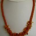 Narancssárga fonott nyaklánc sokféle gyöngymintás középpel, Ékszer, Nyaklánc, Narancssárga apró gyöngyök 8 szálra fűzése után kumihimo fonással készítettem a nyaklánc..., Meska