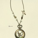 Éhezők viadala óralánc - nyakláncos óra, bronz alapon, A népszerű filmek szimbólumával, a fecsegő po...