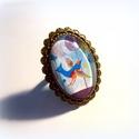 Jégmadár- gyűrű, Ékszer, Képzőművészet, Illusztráció, Gyűrű, Üveg mögé zárt mesék. Festményem egy részletét tettem üveg alá, s tettem fém foglalatba. A gyűrű any..., Meska