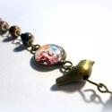 Boldogság kék madara karkötő, Ékszer, óra, Képzőművészet, Karkötő, Igazi romantikus, művészetkedvelő darab. Különleges porcelán  gyöngyökkel, a medálon üveg mögé zárta..., Meska