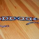 Szimmetrikus halas szalag, Ékszer, Karkötő, A szalag csomózással készül, hímzőfonalból.Színei: fekete, kék, fehér, narancssárga. Mér..., Meska