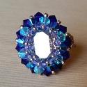 Michaela - Kék és lila Swarovski kövekből, illetve arany kásagyöngyből fűzött elegáns gyűrű, Ékszer, óra, Gyűrű, Gyöngyfűzés, Michaela nevű gyűrűm Mihály arkangyal színeit viseli: kék, lila és arany gyöngyökből készült. Közép..., Meska