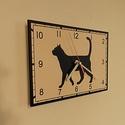 Macskás falióra, Dekoráció, Otthon, lakberendezés, Falióra, óra, Saját tervezésű grafika. Kézi körkivágás. Téma: macskás óra. Téglalap alakú, különleges helyiértékek..., Meska