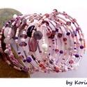 Lila varázslat ~ karkötő, Ékszer, Karkötő, A lila és rózsaszín többféle árnyalatából rengeteg féle gyöngyöt memóriadrótra fűztem, így készült e..., Meska