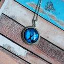 Kék pillangós nyaklánc, Ékszer, Nyaklánc, Gyönyörű kék színű pillangó képét helyeztem ezüst színű medálalapba. A kép és a medá..., Meska
