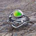 Ezüst Ammolit gyűrű, Ékszer, Gyűrű, Ammolit ezüstbe foglalva.   Az ammolit, ammoniteszek réteges aragonittá alakult fosszilis héja, amel..., Meska