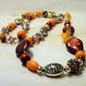 Nyaklánc arany-bordó-narancs színekben, Ékszer, óra, Nyaklánc, Csillogó, színes, divatos. Üveg és műanyag gyöngyök felhasználásával készült a nyaklánc..., Meska