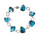 aquamarine kék karkötő, Ékszer, óra, Ez a karkötő 7 db kék színű, színjátszó üveg gyöngyből készült, ezüstözött réz dró..., Meska