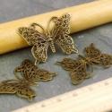 Antik bronz pillangó medál, fityegő, Antik bronz színű, kb. 36x26 mm méretű pillang...