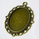 Antik bronz színű, csipkés medál alap (18x25 mm), Méret: 39x28mm  Belső átmérője: 18x25mm  Szí...