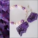 Lila színű teklagyöngyös karkötő masnival, Ékszer, Karkötő, Rózsaszín, lila és bézs színű  teklagyöngyökből készítettem ezt a karkötőt. Díszítésként lila színű ..., Meska