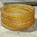 Aranyló karkötő , Ékszer, Esküvő, Karkötő, 3 mm-es áttetsző arany kásagyöngyök sorozata memória karkötőn 12 sorban.  Csillogó ékszer.  10000 fe..., Meska
