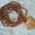 ÚJ! Natúr fa gyöngyös nyaklánc rombusz medállal, Ékszer, Nyaklánc, Több soros kb. 6 mm-es korong alakú fa gyöngyös nyaklánc. 8,5 cm hosszú rombusz alakú fa medállal. D..., Meska