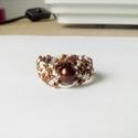 Barna pepita gyűrű, Ékszer, óra, Gyűrű, Drapp és barna fonalból hoztam létre ezt a gyűrűt, melyet a közepén egy fényes barna gyöngy..., Meska