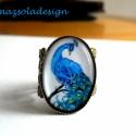 Pávás gyűrű, A kék páva hazája délkelet Ázsia, hazájában...