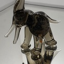 Elefánt (füstszínü üveg), Otthon & Lakás, Dekoráció, Díszüveg, Üvegművészet, Négy lábán álló elefánt felfelé álló ormánnyal, ami (mint tudjuk) szerencsét hoz, elöre mutató agya..., Meska