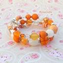 Orange Star - narancs - fehér karkötő válogatott gyöngyökből, Ékszer, Karkötő, Kétsoros memóriadrótra fűztem mindenféle méretű, formájú narancssárga, fehér és átlátszó gyöngyöt. V..., Meska
