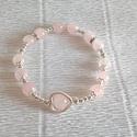 Szeretet- szerelem karkötő rózsakvarc ásványból, Ékszer, óra, Karkötő, Ékszerkészítés, 13db 8mm rózsakvarc ásvány gyöngyöt fűztem fel egy gumis damilra. Sziv alakú gyöngykeretet és több ..., Meska