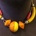 narancs - sárga golyó, Ékszer, Nyaklánc, Dupla sötétbordó hengerbőrre fűzött narancs-sárga kerámia gyöngyök, sárga-piros fa henger..., Meska