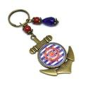 Piros hajókormány üveglencsés kulcstartó táskadísz , Mindenmás, Dekoráció, Kulcstartó, Ünnepi dekoráció, Gyöngyfűzés, Ékszerkészítés, Kék és piros gyöngyökből, kormánykerék mintával díszített üveglencsés kabosonból készült kulcstartó..., Meska