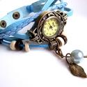 Világoskék órakarkötő /  karkötő óra+ajándék fülbevaló+charm, Ékszer, óra, Fülbevaló, Karóra, óra, Karkötő, Különleges óra bronz színű foglalatban világoskék színű műbőr szíjjal. 2 levehető charm..., Meska