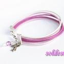 Pink-fehér bőr karkötő, Ékszer, Karkötő, Pink, rózsaszín és fehér bőrszálakból készítettem ezt a csajos karkötőt. A végére egy fém masnit és ..., Meska