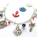 Tengerész karkötő, Ékszer, óra, Karkötő, Irány a tengerpart! :)  ezüst színű tengerész karkötő  A karkötőt tengerész témájú medálok, és csíko..., Meska