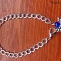 Őrangyal karkötő, Ékszer, Karkötő, Ékszerkészítés, Az ezüst színű láncra gyöngy angyalka került,ezért lett őrangyal a neve. :) A lánc hosszúsága kb: 2..., Meska