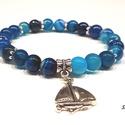 Kék csipkés achát ásványgyöngy karkötő, Ékszer, Karkötő, A karkötő kék színű achát ásványgyöngyökből készült erős gumidamilra fűzve. Díszítésként ezüst színű..., Meska