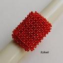 Piros gyöngyfűzött koktélgyűrű, Ékszer, Gyűrű, Egyedi, saját tervezésű, különleges formavilágú, dekoratív gyöngyfűzött koktélgyűrű.  Körmérete: kb...., Meska