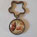 Üveglencsés kulcstartó, Ékszer, Ékszerkészítés, Virág formájú kulcskarikával készült ez a 3 cm átmérőjű fém alapú üveglencsés kulcstartó., Meska