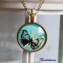 Fekete pillangó üveglencsés nyaklánc, Ékszer, Nyaklánc, 30 mm átmérőjű, fekete pillangót ábrázoló lencse lapul a sima szélű antik bronz színű me..., Meska
