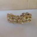 Arany nyitófüleskarkötő, Ékszer, Karkötő, Aranyszínű nyitófülből és aranyszínű szalaggal készítettem ezt a karkötőt.Ezüst színű..., Meska