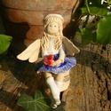 Kék  szoknyás angyalka, Dekoráció, Képzőművészet, Szobor, Kerámia, Fehérre égő agyagból készítettem ezt a huncut Angyalkát,akinek még egy pillangó is rászállt a kezére..., Meska