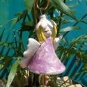 Virágtündér, Dekoráció, Képzőművészet, Szobor, Kerámia, Fehérre égő agyagból készítettem ezt a tündérkét. A ruhája csipke nyomott ,antikolt lila,kalapkája e..., Meska