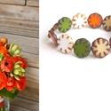 Csupa virág karkötő, Ékszer, Karkötő, Négy különböző színű, table cut típusú, virág formájú gyöngyöt fűztem sorba gumis dam..., Meska